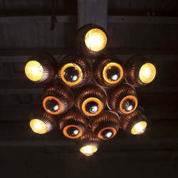 The Iris Chandelier by designer/maker Tim Lewis is made from polished copper toilet floats and light parts.