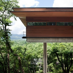 House in Asamayama by Kidosaki Architects soars over a green mountainside in Japan.