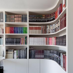 Beautiful apartment designed by Filipe Melo Oliveira and photographed by João Morgado. Love the curved bookshelves!