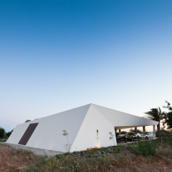 An angular new home in the south of Portugal has become a man made centerpiece between a family of 400 olive trees! Vitor Vilhena Arquitectura built a stark white shell around the house to provide temperature control against the beaming sun.