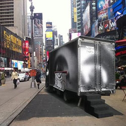French street artist JR brings his Inside Out Project to Times Square starting Monday. People are invited to take their poster-size self portraits in his photo booth truck.