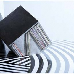 Unknown Pleasures by Jim Lambie is an exhibition by changing the entire museum into a single sculptural space using black & white plastic tape in precise geometric patterns over entire floors.