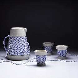"Eindhoven based designer Joon Lee looks to old artifacts when designing tableware that engages people to converse at the table. The ""Drink Link"" tea set consists of a teapot connected to its cups, directly linking every person to each other."