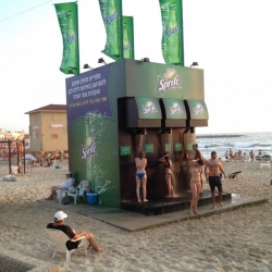 Cool promotional effect with this shower, designed to look like a giant Sprite soda dispenser