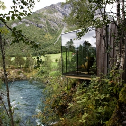 Juvet Landscape Hotel by Jensen & Skodvin Arkitektkontor. Basically each room is a detached small independent house with one, or sometimes two of the walls constructed in glass. In this way every room gets a awesome view of dramatic landscape.