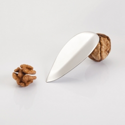KRTZ, tool for opening walnuts, with its shape based on a walnut leaf, ergonomically adapted for use. Hand crafted from stainless steel.