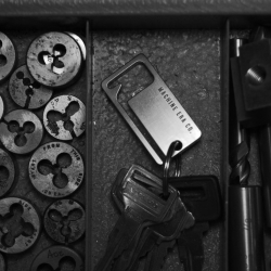 Solid Steel Keysquare, a brilliantly crafted solid steel keychain with bottle opener that is machined from solid steel.