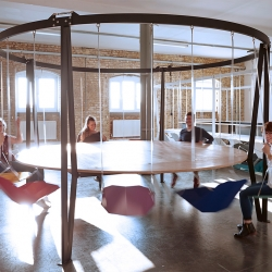 The King Arthur Round Swing Table, bring the playground into the boardroom or dining room, make meetings or dinners fun and inspiring experiences. By Duffy London.