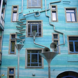 The Kunsthof Passage in Dresden include the 'Court of Water' – contraption made with metal tubes and funnels that make music when it rains. Just one of three creative courtyard façades.