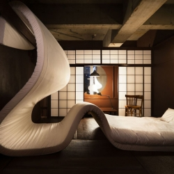Pieke Bergmans's hotel room filled with an enormous undulating mattress is part of the LLOVE exhbition currently on show in Tokyo.