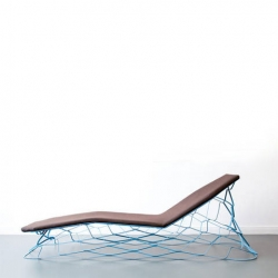 The idea of Loll is to transfer the idea of stretching metal from 2D to 3D into furniture solutions. Stretching the laser cut steel sheet up to maximal strain creates a static equilibrium. E27 make both a lounger and coffee table.
