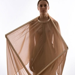 "Swedish fashion designer Mina Lundgren creates a dialogue between the feminine silhouette and the shape of the cube, resulting in experimental collection ""The Cube""."