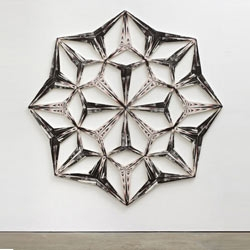 Tillman Kaiser created a series of kaleidoscopic sculptures formed by intricate layers of painted canvas and cardboard.