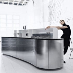 Designed by Alessandro Mendini for Valcucine, the LaCucinaAlessi kitchen stems from the poetry of the curved line.