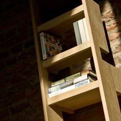 Designer Casimir was inspired by the ladder's original form and function – a movable stairway – and an immovable shelving unit have now been merged one, by extending the ladder's rungs into shelves and cases of different sizes.