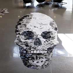 20' long anamorphic recycled paper skull installation from Skull-A-Day's Noah Scalin.