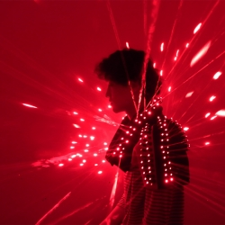 AMAZING laser suit. This performance costume is made of nylon and embedded with 200 laser diodes. By Wei-Chieh Shih.