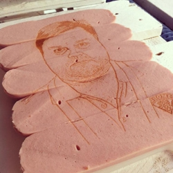 Portrait of a former finnish ice-hockey player laser engraved on sausages. Portrait/design by Aapo Mattila. Engraved by the Laser Cut Studio in Helsinki, Finland.