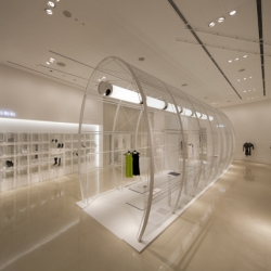 Japanese based designer Noriyuki Otsuka recently completed the design of a all white shop with a mesh portal in the upcoming neighborhood of Umeda in Osaka, Japan.