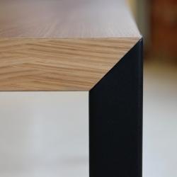 Steel meets wood in a 45 degree angle. A table by Belgian designer Lennart Van Uffelen
