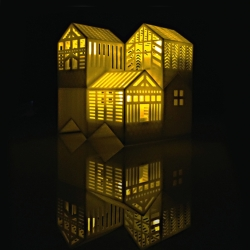 Fun 3d print house lanterns, by Vancouver based designer Becki Chan. The little houses can stack into a bigger house or a tower, and they are lit by LED tealights.