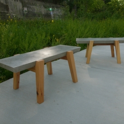 Lincoln Supply benches by John Truex have cast concrete tops with bases made from reclaimed old growth pine, salvaged from a former factory building in Syracuse, NY.