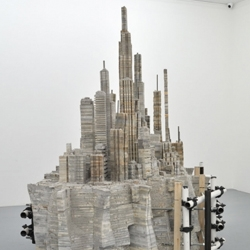 Chinese artist Liu Wei creates chaotic cityscape installations; some using stacked schoolbooks, others with edible dog chews.