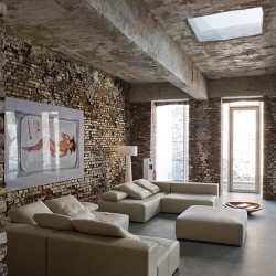 A warehouse converted into a loft in Dusseldorf, Germany, by Belgian architects AABE Erpicum & Partners.