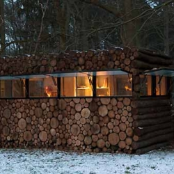 This unique cozy place is designed by Piet Hein Eek, located in Hilversum Netherlands. This quiet small office is belongs to Hans Liberg. All of the exterior is made from logs.