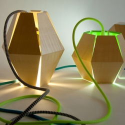 The unique Capside Lamps by  Loïc Bard can double as hanging light fixtures or floor lamps.