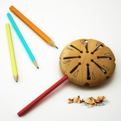 Lollypop is a wooden pen sharpener that has eight holes for pencils in different diameters and also different cross section. Designed by Hakan Gürsu of Designnobis, Lollypop was honored in A' Design Award 2014-2015 with a golden award.