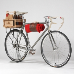 Lumbürr Co's fully loaded new bicycle includes the Cedar Rear Crate, Six-Pack-O-Kubb with game, Brooks canvas and rubber saddle, wool blanket with blanket carrier, custom hand-carved antler handlebars, and raw-finish steel frame.