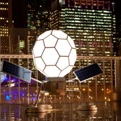 Solar powered lunar sculpture by Spencer Finch uses the sun's energy to produce moonlight in Chicago.