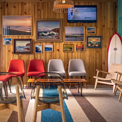 MG2 brings surf culture to new Smith Dental office in Nashville. Experience features one-of-a-kind art pieces, colorful treatment rooms — each tied to a famous surf locale — and refinished accents reflective of boarding culture.