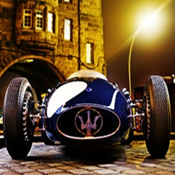 One of the world's rarest automobiles, the Maserati 250f hits the streets of Hamburg under the lens of Bernd Kammerer.