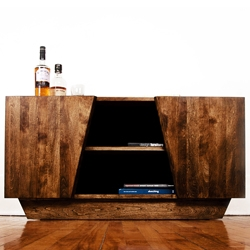 Living room media storage by Etic Design. Locally handcrafted cherry wood furniture piece with unique angular doors to give a little twist and a modern feel to the usual living room TV unit.