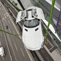 Mercedes-Benz SLS AMG lifted 42 meter in to the air for exhibition at the Mercedes-Benz museum in Germany.