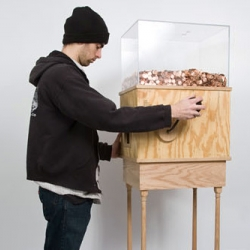 Blake Fall-Conroy makes things that make a social or political statement. His new work-in-progress is titled Minimum Wage Machine, which actually makes you work for minimum wage.