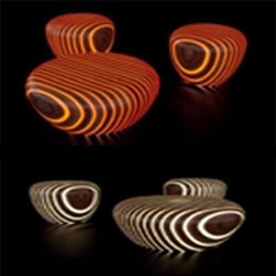 This is the design of chairs and tables made from pieces of wood and resin strips that glow in the dark color. Designed by Giancarlo Zema and exhibited at the Milan Furniture Fair.