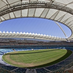 The Moses Mabhid Stadium in South Africa for the FIFA 2010 World Cup features a cable-car that rides up the soaring arch to a skydeck for prime viewing and was partially constructed from the old stadium.
