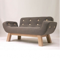 Upholstered in 100% eco worsted wool, with solid oak legs and oversized felt buttons, the M Series lends a whimsical twist to yellow diva's collection.