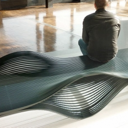 French designer Alexandre Moronnoz designed a dynamic and fluid bench named it as Muscle Bench. The bench offers the possibility of sitting or lying down in response to the surface's relief.