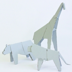 My Zoo by Martí Guixé, a series of gigantic animals made of cardboard, all white, for Magis. The children will be able to sit on them and color them, but also go inside them. The whale will be eight meters long, enormous!