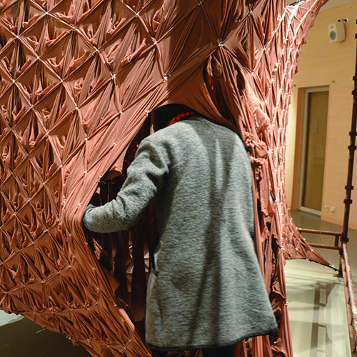 'Skin' by NEON is a sculpture that explores body and architectural space as one. Constructed using 1800 pairs of skin colored tights held in tension, it is hoped that the inhabitant will begin to lose the sense of where their body ends and space begins.