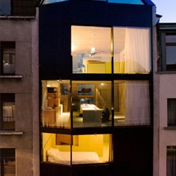 'Nest' is an incredibly narrow home in Antwerp. Four meters by twelve meters deep! Amazing what could be done in the space. By CSD architecten.
