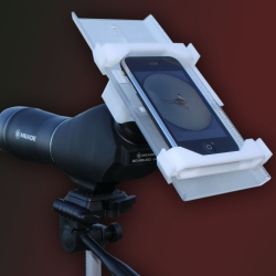 The SkyLight is a sleek, minimalist adapter that connects smartphones to microscopes and spotting scopes. The smartphone camera can then capture photos and videos for uploading, e-mailing, and sharing on the web.