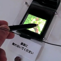 Video of NTT DoCoMo's touchable 3D display prototype. A glasses-free 3D display uses haptic-enabled stylus to allow viewers 'touch' and interact with the images displayed.