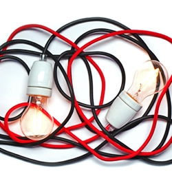 'NUD classic' lamp combines simple textile cord (44 colors available) with porcelain holder. Cool simplicity.