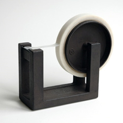 Jurgen Lehl's tape dispenser is part of its 'Nambu' Ironware collection which includes objects like bottle openers, chopstick rests and mosquito coil containers. Quite sculptural cast iron objects.