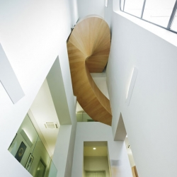 This maple-veneered staircase twists and turns between the floors of an Olympic Museum in Georgia refurbished by UK and Georgia firm Architects of Invention.
